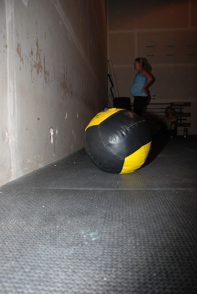 It's as though she has to do two 14 lb. wall balls at once! Aimee rocking the CrossFit Games Open WOD 13.3