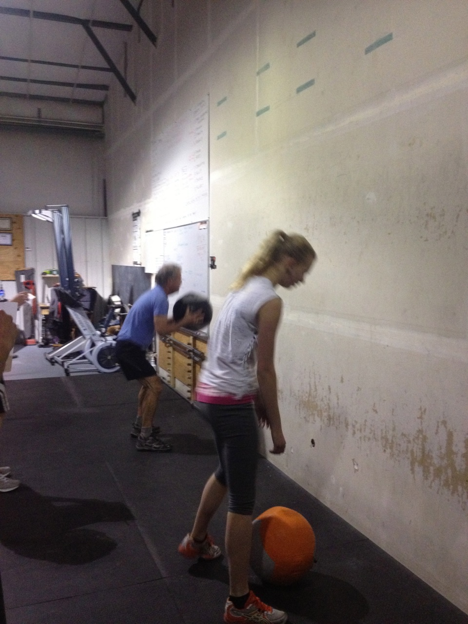Olivia and Josh working hard during CrossFit Games Open WOD13.3. Wall Balls are fun!